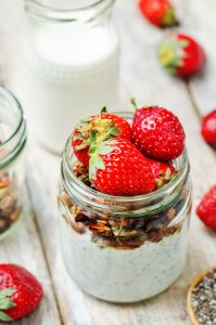 Chia seeds granola Greek yoghurt pudding with strawberries. toning. selective focus